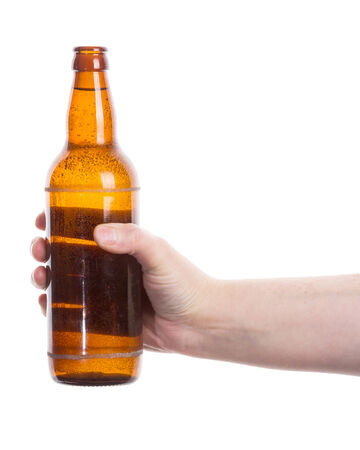 hand holding bottle: Beer bottle in the hand isolated on white