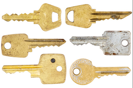Big size set of old keys isolated on white  photo