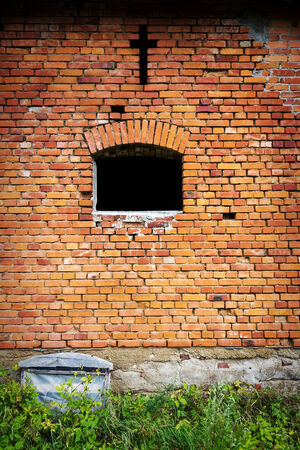 Red brick wall background with cross over window photo