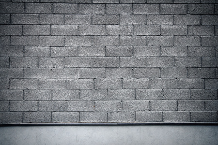Gray tiled wall with a blank gray bricks   photo