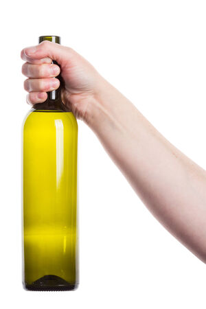 Open wine bottle in the hand isolated on white    photo