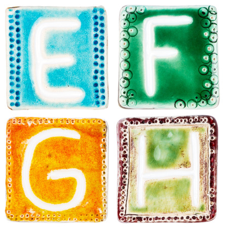 Colorful handmade ceramic letters isolated on white  photo