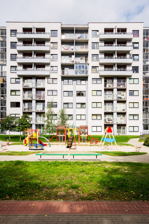 Modern apartment building with kids playground