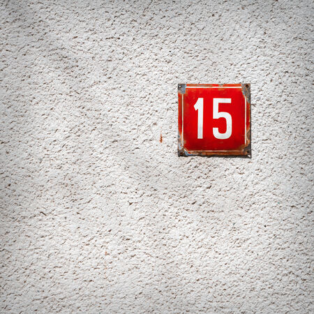Number 15 on textured concrete wall photo