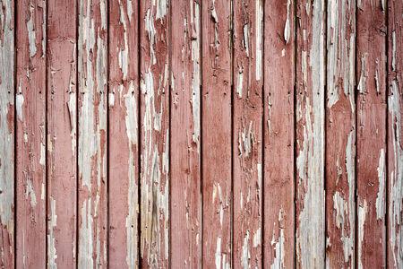 Peeling brown paint on weathered wood texture photo