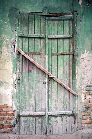 Old green door of a abandoned house photo