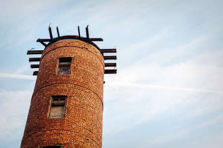 strategical: Big tower of an old medieval castle facing the sky Stock Photo