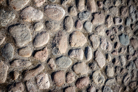Detail of old stone paving photo
