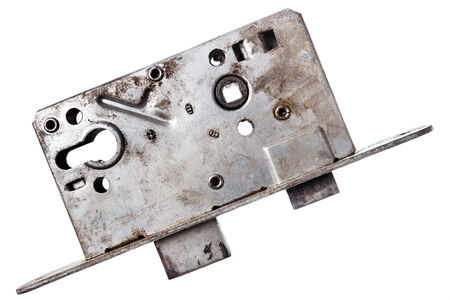 Closeup shot of old door lock isolated on white  photo