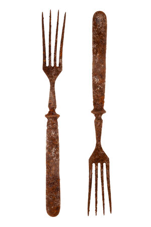 grunge flatware: Both sides of an old rusty fork isolated on white