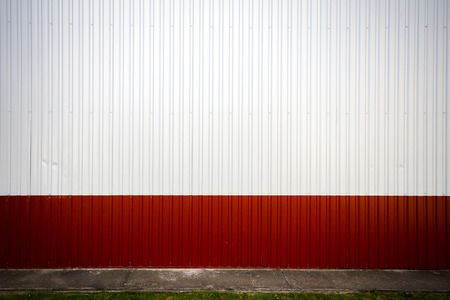 grooved: Red and white industrial grooved metal wall