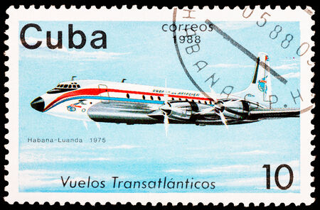 CUBA - CIRCA 1988: A Stamp printed in CUBA shows image of the airplane in transatlantic flight, Havana - Luanda in 1975, circa 1988