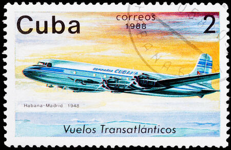 CUBA - CIRCA 1988: A Stamp printed in CUBA shows image of the airplane in transatlantic flight, Havana - Madrid in 1948, circa 1988