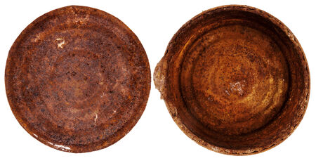 Top and bottom of an old rusty tin can isolated on white photo