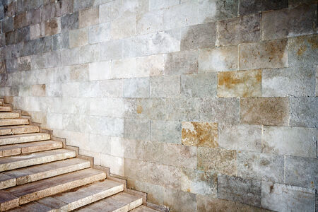 Aged wall with stairs detail photo