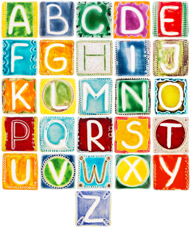 Big size colorful handmade ceramic alphabet isolated on white photo