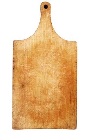 Used wooden chopping board isolated on white background Foto de archivo