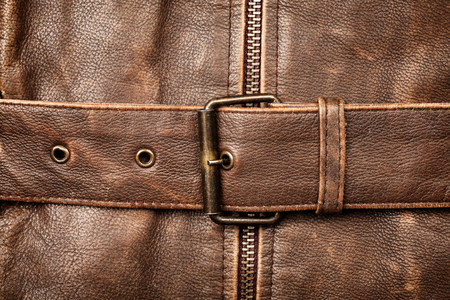 Closeup of a leather texture with a belt buckle photo
