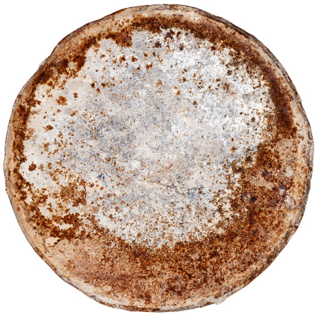 Rusty round metal plate isolated on white photo