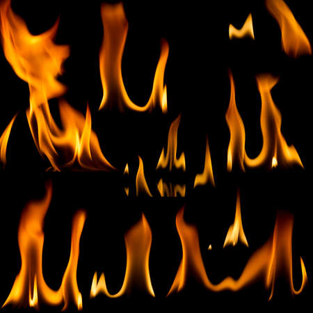 Set of fire flames isolated on black background photo