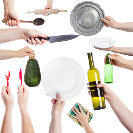 Hand holding various kitchen utensils isolated on white background photo