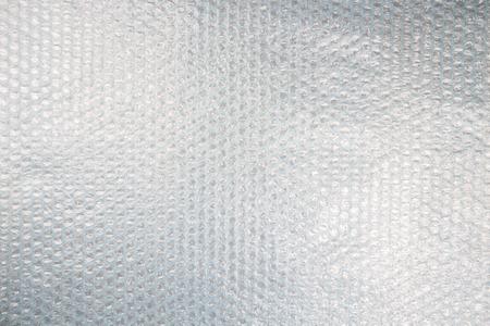 Plástico plástico de burbujas textura de fondo, rayos desigual Foto de archivo - 34241803
