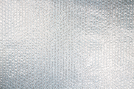 Plastic bubble wrap texture background, uneven lightning