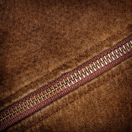 Brown suede texture and zipper background photo