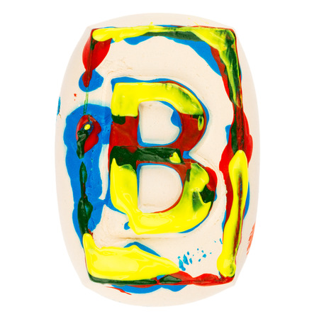 educaton: Handmade of white clay letter B painted with colorful acrylic paints isolated on white