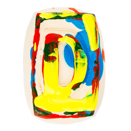 Handmade of white clay letter D painted with colorful acrylic paints isolated on white