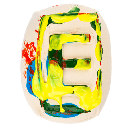 educaton: Handmade of white clay letter E painted with colorful acrylic paints isolated on white Stock Photo