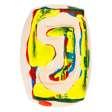 Handmade of white clay letter J painted with colorful acrylic paints isolated on white