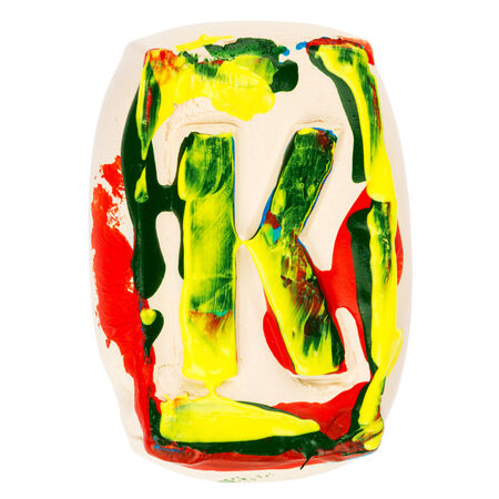 educaton: Handmade of white clay letter K painted with colorful acrylic paints isolated on white Stock Photo