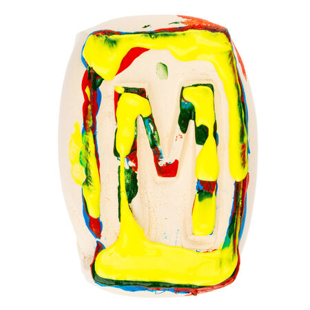 educaton: Handmade of white clay letter M painted with colorful acrylic paints isolated on white