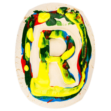 educaton: Handmade of white clay letter R painted with colorful acrylic paints isolated on white Stock Photo