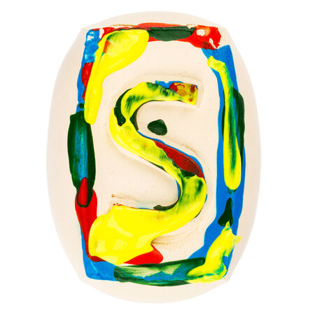 Handmade of white clay letter S painted with colorful acrylic paints isolated on white