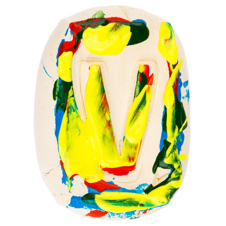 educaton: Handmade of white clay letter V painted with colorful acrylic paints isolated on white