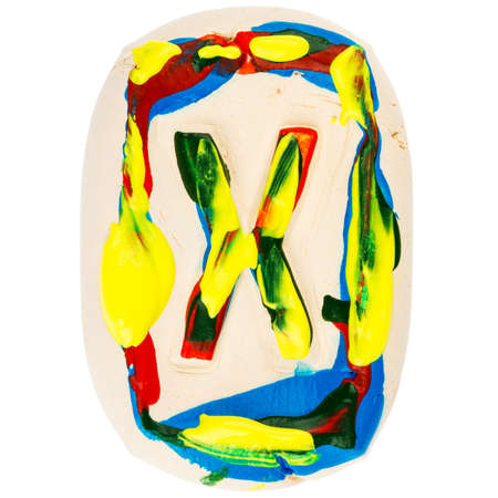 educaton: Handmade of white clay letter X painted with colorful acrylic paints isolated on white