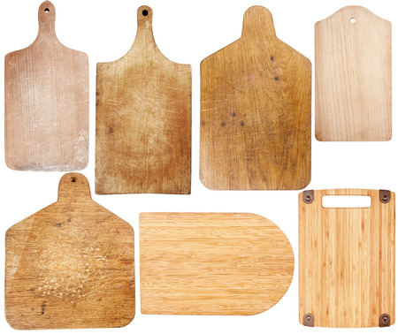 Set of new and used cutting boards isolated on a white background photo