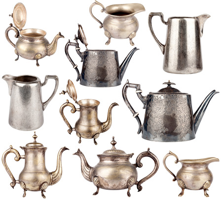 Collection of antique teapots isolated on white background Foto de archivo