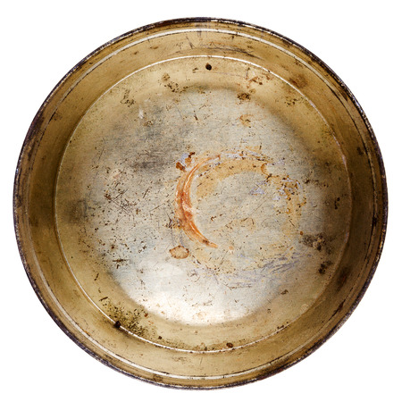 Rusty round metal tin can isolated on white photo