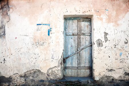 Old blue door of a abandoned house photo