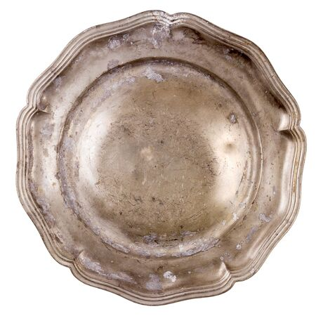 Old pewter plate isolated on white background photo