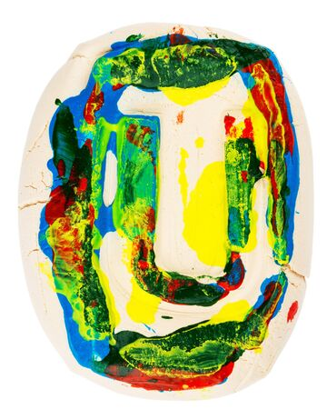 Handmade of white clay letter U painted with colorful acrylic paints isolated on white photo