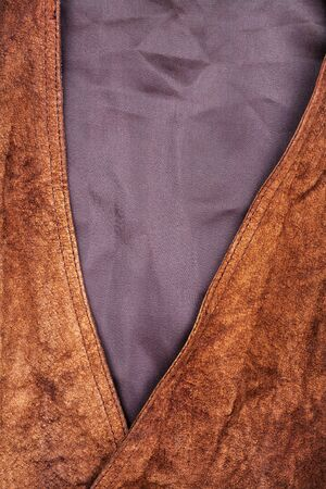 the vest: Fragment of brown suede vest Stock Photo