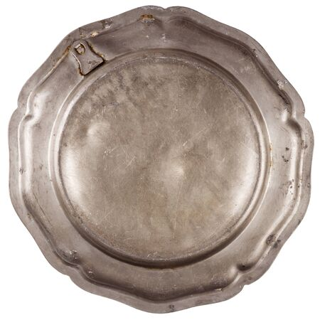 pewter: Bottom of old pewter plate isolated on white background
