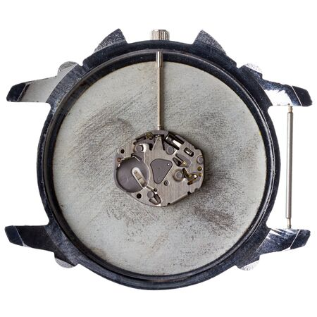 watch movement: Quartz watch movement in old grungy clock isolated on white background