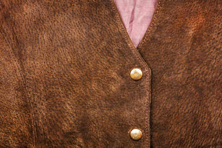 Fragment of brown suede vest Stock Photo