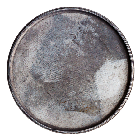 Grungy round metal plate isolated on white photo