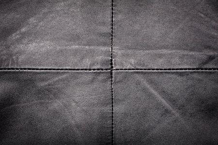 seam: Black worn leather texture with seam